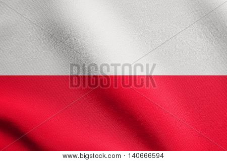 Flag of Poland waving in the wind with detailed fabric texture. Polish national flag.