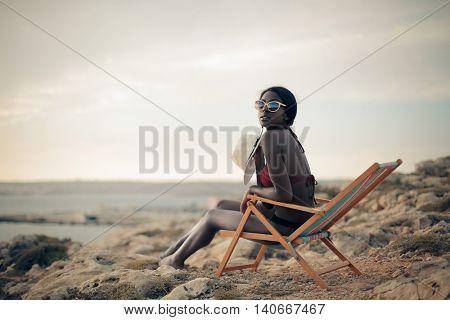 Sitting in a deckchair at the beach