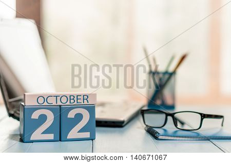 October 22nd. Day 22 of month, calendar on financial adviser workplace background. Autumn concept. Empty space for text.