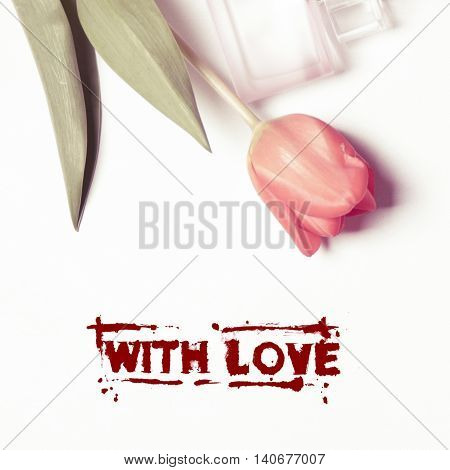 Postcard series with LOVE perfume and a tulip flower with green leaves on a white background