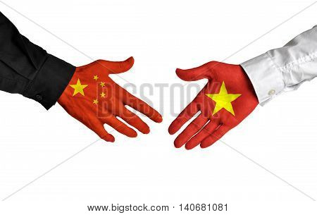China and Vietnam leaders shaking hands on a deal agreement