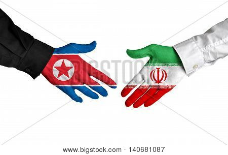 North Korea and Iran leaders shaking hands on a deal agreement