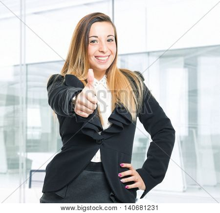 Portrait of a woman doing thumbs up sign