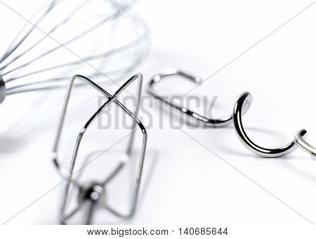 Egg beater or wire whisks, close-up. Isolated on white.