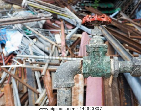 The old water valve in the scrapyard.