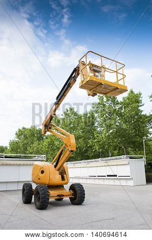 Diesel Powered Articulating Boom Lift in a park