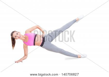 Lady Working Out Standing In Plank Position