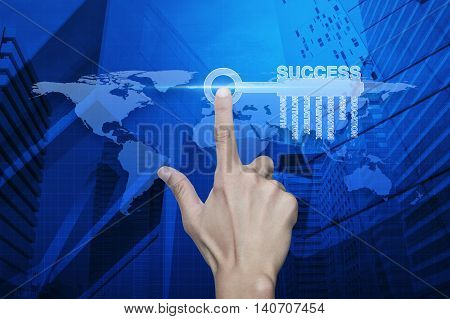 Hand pressing key with business words over map and city tower Success business concept Elements of this image furnished by NASA