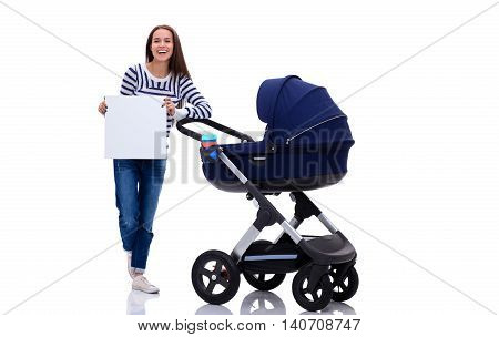 Full length portrait of a mother with a stroller holding blank card, isolated on white background
