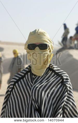 Tourist Dressed Like Bedouin With Sunglasses