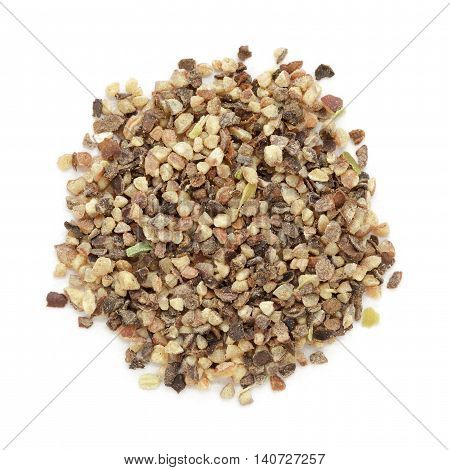 Organic Black pepper (Piper nigrum) peppercorn in big cut size. Isolated on white background. Macro close up. Top view.