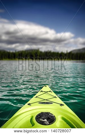 Neon green kayak on the water at Horseshoe Lake, Montana