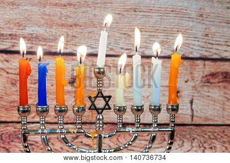 Image of jewish holiday Hanukkah background with menorah traditional candelabra Burning candles menorah, hanuka