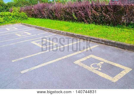 Parking for the disabled - road signs printed on the asphalt. Road pictogram parking for the disabled