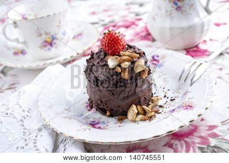 Chocolate Torte with Nuts and Strawberry on Plate
