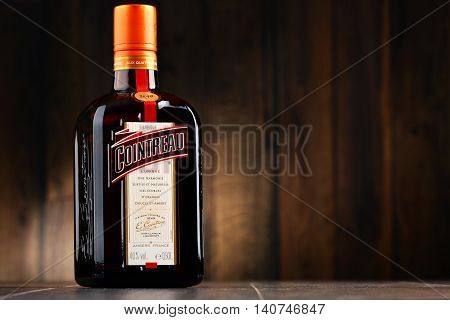 POZNAN POLAND - JULY 27 2016: Great component of several well-known cocktails Cointreau is a brand of French triple sec (an orange-flavoured liqueur). It is also drunk as an aperitif and digestif