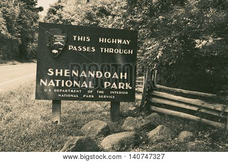Sign showing entrance to Shenandoah Nation Park, Virginia black and white.