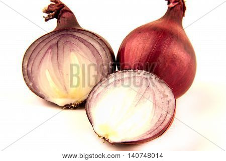 Red sliced and unpeel onion isolated on white background