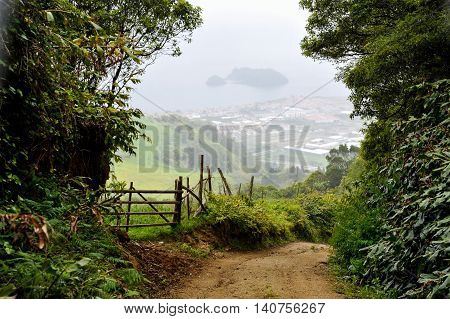 Downhill landscape from the trekking path towards the town Villa Franca in Sao Miguel Island of Azores