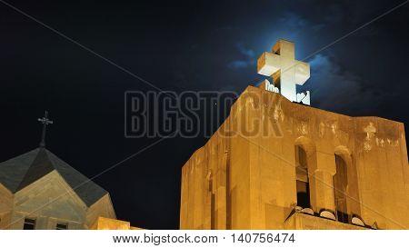 Cross of the Saint Gregory the Illuminator Cathedral in Yerevan, Armenia at night. Illuminated roof with dark sky