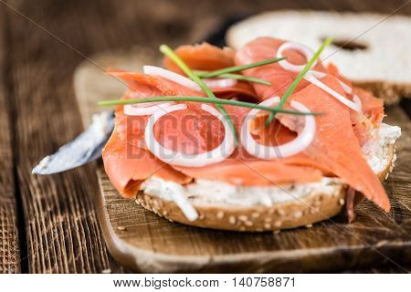 Bagel With Salmon On Wooden Background