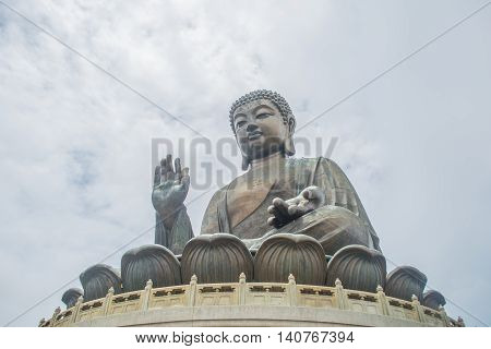 Tian Tan Buddha and bright blue sky with white cloud in sunny day in Hong Kong.