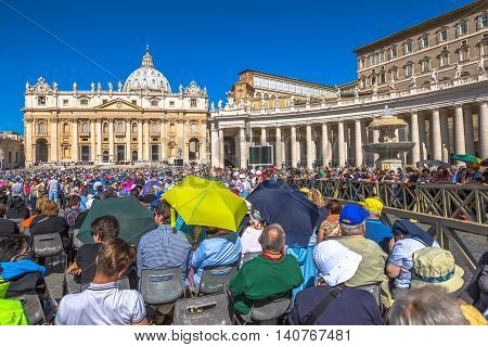Rome, Italy - June 18, 2016: Pope Francesco speaking to people in Piazza San Pietro for jubilee event. On background, the popular landmark of St. Peter's Basilica.