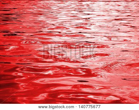 reflection of light on the waves ,red water and light from the sun in pool ,water level , red abstract background