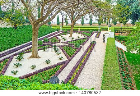 The patterns of the flower beds look like the carpet covering the eart in Bahai Garden Haifa Israel.
