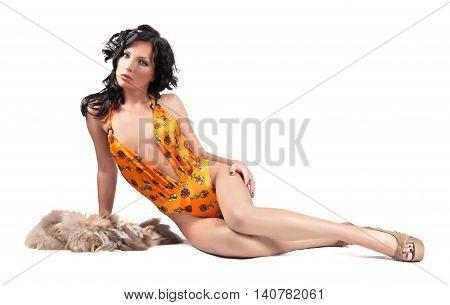 beautiful woman lying on a light background