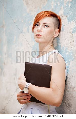 Young Red Hair Woman With File