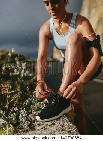 Fitness Woman Lacing Sport Shoes Before Run