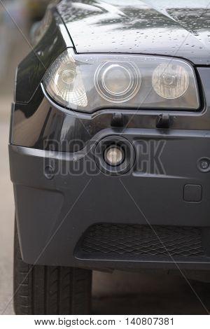 modern automobile headlight. close-up. auto background. xenon.