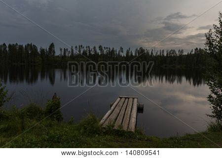 wooden pier on Vetrenno lake, the Karelian isthmus, Leningrad oblast, Russia