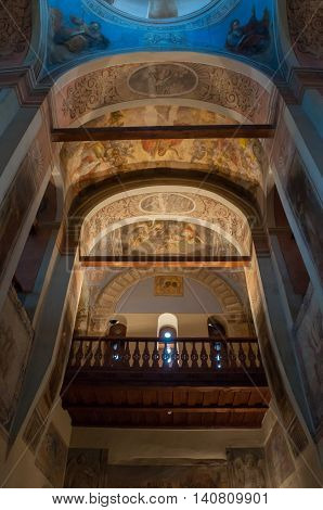VELIKY NOVGOROD RUSSIA-JULY 15 2016. Architecture elements- decorated arched ceiling with colorful paintings of Bible scenes and choirs in the interior of St Nicholas Cathedral. Soft focus applied
