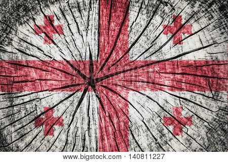 Flag of Georgia on cracked wooden texture