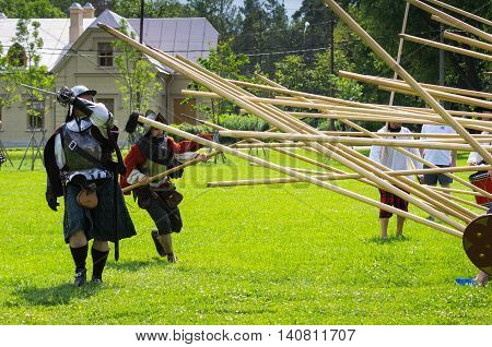 PETERHOF- JULY 07: Reconstruction of knightly fight in Peterhof on July 07 2013 SAINT-PETERSBURG RUSSIA. The festival
