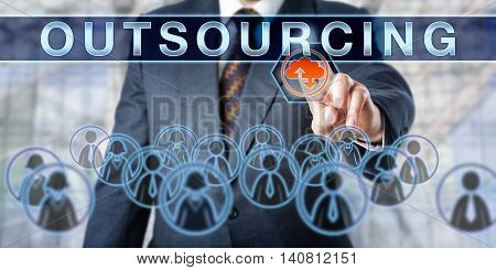 Business manager is pushing OUTSOURCING on an interactive control screen. Business management metaphor and information technology concept for outside resourcing and transfer of employees.
