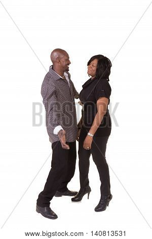 Middle aged couple standing close interacting isolated on white