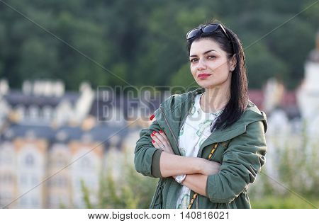 Portrait of a beautiful woman on the street. People
