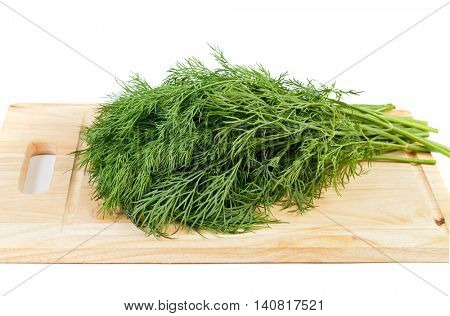 bunch of fresh organic dill on a wooden kitchen board