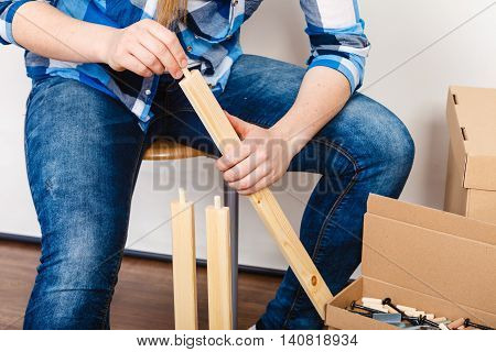 Woman Assembling Wood Furniture. Diy.