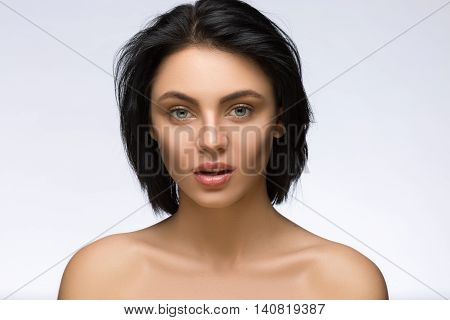 Fringe. Fashion Model Girl With Trendy Hairstyle. Haircut. Stylish Beauty Brunette Woman Face. Beautiful Make up. Vogue Style. Hair cut. Perfect Skin. Surprised Woman