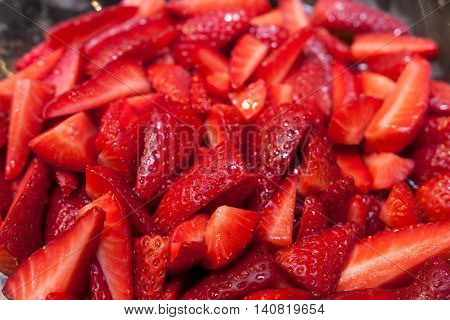 cuts of fresh juice strawberry in a bowl