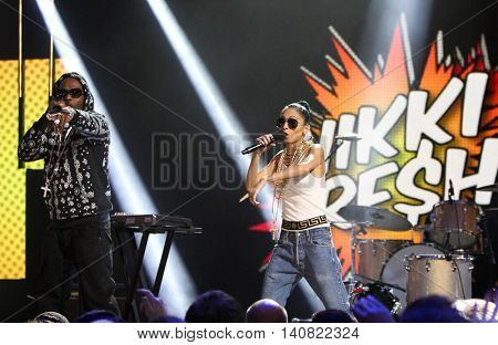 NEW  YORK-NOV 13: Nicole Richie (R) and Anthony 'Treach' Criss perform during VH1's 2nd Annual 'You Oughta Know Live In Concert' 2014 at Hammerstein Ballroom on November 13, 2014 in New York City.