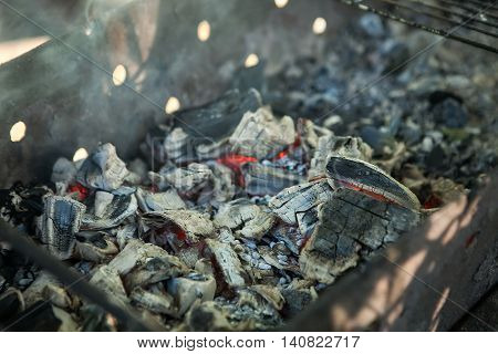 Glowing Hot Charcoal Briquettes Close-up Background Texture.