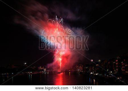 BASEL, SWITZERLAND. 31st July, 2016. Swiss National Day Fireworks with the Mittlere Rheinbruecke in the background in Basel, Switzerland.