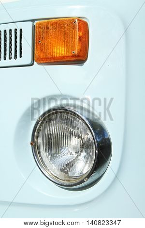 Close up image of headlight of vintage car