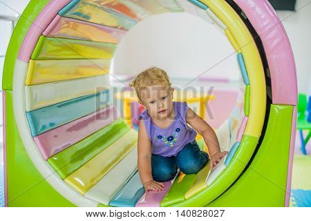 Todler Girl Sits In The East Tunnel