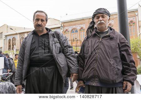 Tehran Province- IRAN-March 17 2016 A Portrait of Two Kurdish Old Seller Man at Tehran Urban Street